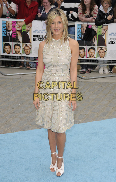 JENNIFER ANISTON.Horrible Bosses UK Premiere, BFI, London, England..20th July 2011.full length  length white cream dress sheer gold folds folded pleats pleated sleeveless braid braided belt sequins sequined ribbon ankle shoes peep toe  .CAP/CAN.©Can Nguyen/Capital Pictures.