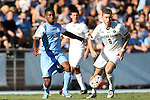 18 September 2015: North Carolina's Jordan McCrary (9) and Notre Dame's Jon Gallagher (IRL) (8). The University of North Carolina Tar Heels hosted the University of Notre Dame Fighting Irish at Fetzer Field in Chapel Hill, NC in a 2015 NCAA Division I Men's Soccer match. North Carolina won the game 4-2
