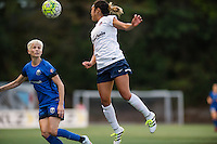 Seattle, Washington -  Sunday, September 11 2016: Washington Spirit defender Caprice Dydasco (3) goes up for a header during a regular season National Women's Soccer League (NWSL) match between the Seattle Reign FC and the Washington Spirit at Memorial Stadium. Seattle won 2-0.