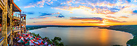 "Oasis Sunset Panorama-  The Oasis panorama at Sunset located in the Hill country outside Austin is the most popular place to capture Lake Travis sun sets. The restaurant is located in far west Austin at the foothills of the Texas Hill Country on Lake Travis. The Oasis restaurant likes to promote itself as the ""Sunset Capital of Texas"" with it decks facing west for maximum sunset views. The restaurant sit on a bluff about 450 feet over the lake overlooking the big bowl at the lake. Lake Travis is part of the Highland lakes, after Mansfield dam was built in 1942 it became the largest reservoir for water storage creating the largest area of water where the Oasis overlook is. The Oasis restaurant is popular with locals and tourist and it not uncommon to find buses lined up in the parking lot. It has become a destination for people traveling in this area of the Hill Country to visit to capture a peak at the sunset. Most people who live in Austin will tell you The sunsets view from this location are great anytime of the year. The Oasis restaurant has been here for thirty years, but in 2005 a lightning fire destroyed parts of the structure but it was back in business about two weeks later over time the portion that had burn down was re-built and expanded for maximun sunset views. This Lake is one of the largest reservoir of water along the Highland lakes. another beautiful sunset in the Texas hillcountry. beecreekphoto.com, Tod Grubbs,"