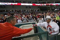 Ohio State football coach Urban Meyer fist bumps Buck I Guy prior to the Cincinnati Reds game against Pittsburgh at Great American Ball Park on Wednesday, April 8, 2015. (Columbus Dispatch photo by Jonathan Quilter)