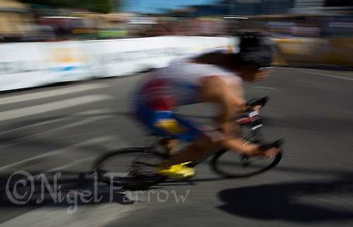 25 AUG 2013 - STOCKHOLM, SWE - Aurelien Raphael (FRA) of France rounds a corner during the bike at the elite men's ITU 2013 World Triathlon Series round in Gamla Stan in Stockholm, Sweden (PHOTO COPYRIGHT © 2013 NIGEL FARROW, ALL RIGHTS RESERVED)