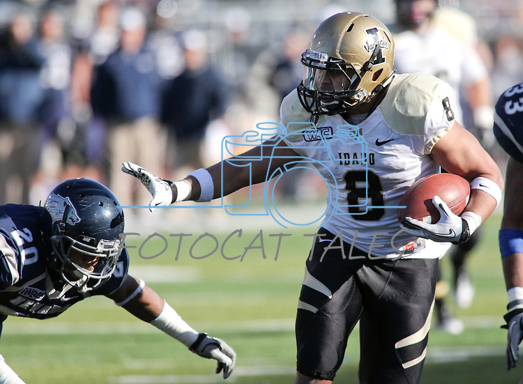 Idaho running back Kama Bailey (8) runs past Nevada defender Duke Williams (20) during the second quarter of an NCAA football game in Reno, Nev., on Saturday, Dec. 3, 2011. .Photo by Cathleen Allison