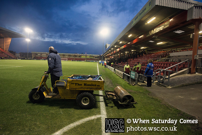 Crewe Alexandra 1 Leyton Orient 2, 18/01/2014. Gresty Road, League One. A groundsman on a motorised roller driving on to the pitch at the conclusion of Crewe Alexandra's home game against Leyton Orient (in yellow) in the SkyBet League One at the Alexandra Stadium, Gresty Road, Crewe. The match was won by the visitors from London by 2-1 with two goals on debut by Chris Dagnall, sending Orient to the top of the league. The match was watched by 4830 spectators. Photo by Colin McPherson.