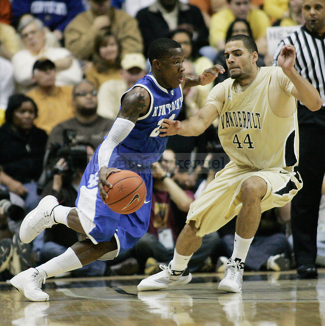 Freshman guard Eric Bledsoe dribbles past Jeffery Taylor in the first half of UK's game vs. Vandy at Memorial Gymnasium in Nashville on Saturday, Feb. 20. 2010. Photo by Britney McIntosh | Staff