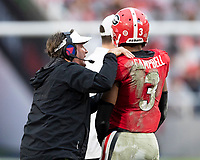 ATHENS, GA - NOVEMBER 23: head coach Kirby Smart of the Georgia Bulldogs instructs Tyson Campbell #3 during a game between Texas A