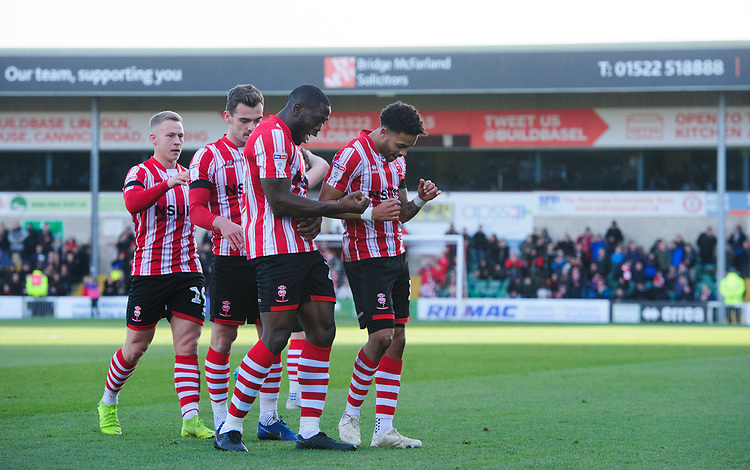 Lincoln City's Bruno Andrade, right, celebrates scoring the opening goal with team-mate John Akinde<br /> <br /> Photographer Chris Vaughan/CameraSport<br /> <br /> The EFL Sky Bet League Two - Lincoln City v Northampton Town - Saturday 9th February 2019 - Sincil Bank - Lincoln<br /> <br /> World Copyright &copy; 2019 CameraSport. All rights reserved. 43 Linden Ave. Countesthorpe. Leicester. England. LE8 5PG - Tel: +44 (0) 116 277 4147 - admin@camerasport.com - www.camerasport.com