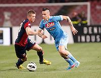 Naples'  Marek Hamsik challenge  Genoa's   Juraj Kucka  during their Italian Serie A soccer match at the San Paolo  stadium in Naples April 7, 2013