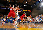 BROOKINGS, SD - JANUARY 17:  Kerri Young #10 from South Dakota State drives against Nicole Seekamp #35 from the University of South Dakota in the first half of their game Sunday afternoon at Frost Arena in Brookings, S.D. (Photo by Dave Eggen/Inertia)