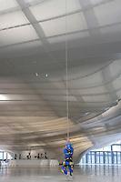 'Gli uomini della corde', addetti alla manutenzione della nuvola<br /> 'Men of ropes', employees for maintenance<br /> Roma 19-07-2016 Apertura in anteprima per la stampa del 'La Nuvola' ideata dall'architetto Massimiliano Fuksas. Per l'occasione l'opera e' stata illuminata per la prima volta con spettacolari proiezioni.<br /> Opening for the press and lighting of 'The Cloud', the new Eur Convention centre by the famous archistar Massimiliano Fuksas. The Cloud's history began 18 years ago, wen the project began, its construction started in 2008, but, due mainly to the huge cost of the opera, the project took almost 10 years to be realized.<br /> Photo Samantha Zucchi Insidefoto