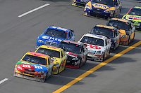 Apr 27, 2008; Talladega, AL, USA; NASCAR Sprint Cup Series driver Kyle Busch (18) leads the field during the Aarons 499 at Talladega Superspeedway. Mandatory Credit: Mark J. Rebilas-