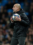 Manchester City manager Pep Guardiola catches the ball during the UEFA Champions League match against Shakhtar Donetsk  at the Etihad Stadium, Manchester. Picture date: 26th November 2019. Picture credit should read: Darren Staples/Sportimage