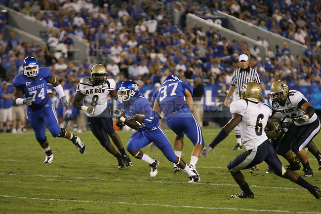 CoShik Williams ran the ball against  the University of Akron at Commonwealth Stadium in Lexington, Ky on Sept. 18, 2010. Photo by Latara Appleby | Staff