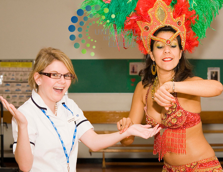 A touch of Latin American at Inverclyde Royal Hospital Greenock, as staff are invited to keep fit with Samba rhythm classes, Brazilian born dancer Thaissa aka Elitricat, is seen with Lyndsey Smith Student Dietitian at the hospital gym. Picture/Johnny Mclauchlan/Universal News and Sport (Scotland)/ 27/08/2008
