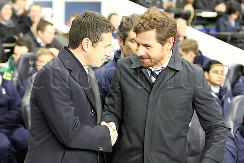 14.02.2013. London, England. Remi Garde Manager of Olympique Lyonnais shakes hands with Andre Villas-Boas Manager of Tottenham Hotspur  before the UEFA Europa League Round of 32 1st Leg game between Tottenham Hotspur and Olympique Lyonnais from White Hart Lane Stadium...