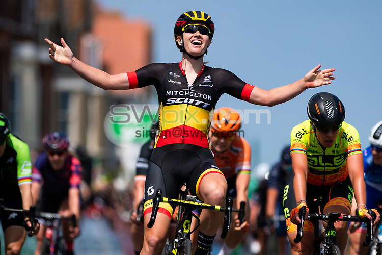 Picture by Alex Whitehead/SWpix.com - 13/06/2018 - Cycling - 2018 OVO Energy Women's Tour - Stage 1, Framlingham to Southwold - Jolien D'Hoore of Mitchelton Scott celebrates winning Stage 1 in a sprint finish.