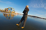 Woman standing on new ice in Yellowknife Bay