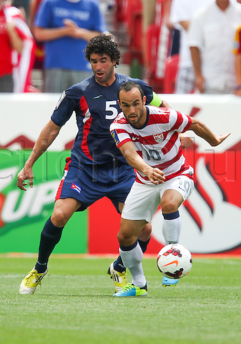 13.07.2013. Sandy, Utah, USA. US Men's National midfielder Landon Donovan (10) works to control the ball in front of Cuba defender Jorge Luis Clavelo (5) during the CONCACAF Gold Cup soccer match between USA Men's National team and Cubaat Rio Tinto Stadium in Sandy, UT. USA.
