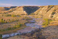 Morning light lights uo the Little Missouri River in Thoeodore Roosevelt National Park in western North Dakota