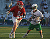Jack Pucci #9 of Syosset, left, carries downfield as Jim Hickey #12 of Farmingdale pressures him on defense during the Nassau County varsity boys lacrosse Class A semifinals at Shuart Stadium, located on the campus of Hofstra University in Hempstead, on Friday, May 25, 2018. Syosset won by a score of 9-4.