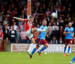 Paul Coutts of Sheffield Utd wins the ball ahead of Stephen Dawson of Scunthorpe Utd during the English League One match at Glanford Park Stadium, Scunthorpe. Picture date: September 24th, 2016. Pic Simon Bellis/Sportimage