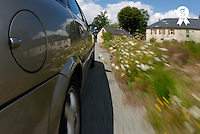 Car driving on country road, close-up, rear view (blurred motion) (Licence this image exclusively with Getty: http://www.gettyimages.com/detail/200502982-001 )