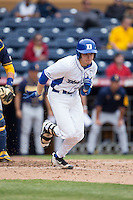 Chris Proctor (23) of the Duke Blue Devils runs towards first base during the game against the California Golden Bears at Durham Bulls Athletic Park on February 20, 2016 in Durham, North Carolina.  The Blue Devils defeated the Golden Bears 6-5 in 10 innings.  (Brian Westerholt/Four Seam Images)