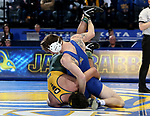 BROOKINGS, SD - FEBRUARY 11: Tanner Cook from South Dakota State University rolls Luke Weber from North Dakota State University during their 174 pound match Friday night at Frost Arena in Brookings, SD. (Photo by Dave Eggen/Inertia)
