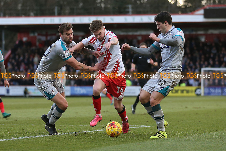 Ben Kennedy of Stevenage tangles with Andrew Boyce (L) and Zak Mills of Grimsby Town during Stevenage vs Grimsby Town, Sky Bet EFL League 2 Football at the Lamex Stadium on 28th January 2017