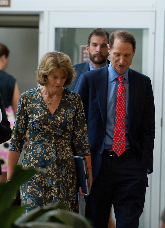 UNITED STATES - May 16: Sen. Lisa Murkowski, R-AK., and Sen. Ron Wyden, D-OR., talk as they walk to the U.S. Capitol from the Senate subway on May 16, 2013. (Photo By Douglas Graham/CQ Roll Call)