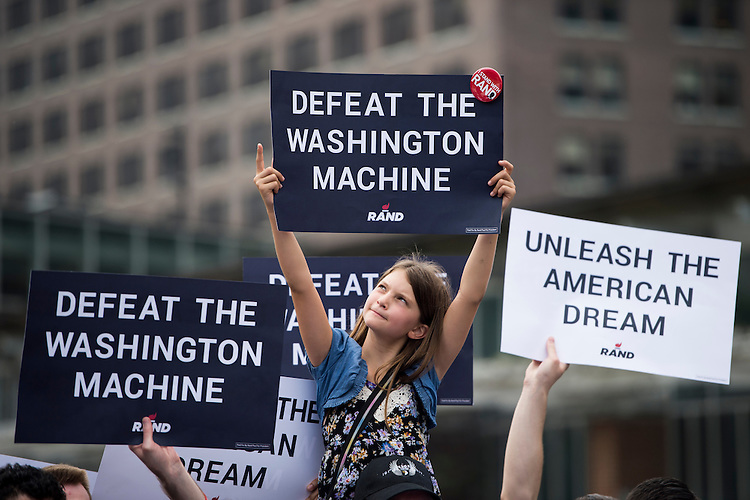 """UNITED STATES - MAY 18: Maya Jacobs, 8, of Ojai, Calif., holds up her """"Defeat the Washington Machine"""" sign as Presidential candidate Sen. Rand Paul, R-Ky., speaks outside of Independence Hall in Philadelphia on Monday, May, 18, 2015. (Photo By Bill Clark/CQ Roll Call)"""