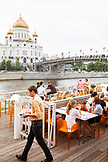 RUSSIA, Moscow. Lunch crowd at the roof restaurant at Bar Strelka which overlooks the Moscow River.