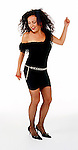 Woman on 1980's garb dancing on white seamless