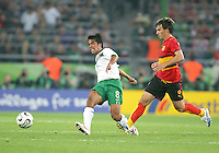 Pavel Prado (8) of Mexico clears the ball from Andre (8) of Angola. Mexico and Angola played to a 0-0 tie in their FIFA World Cup Group D match at FIFA World Cup Stadium, Hanover, Germany, June 16, 2006.