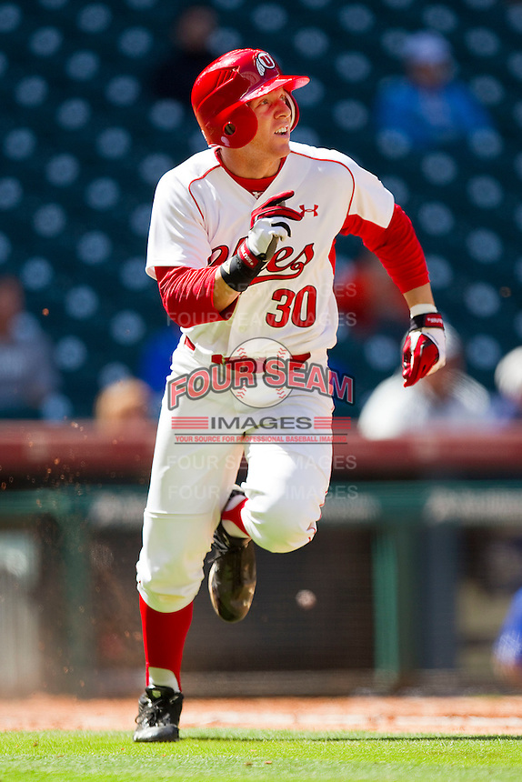 Shaun Cooper #30 of the Utah Utes watches the flight of the ball as he runs down the first base line during the game against the Kentucky Wildcats at Minute Maid Park on March 6, 2011 in Houston, Texas.  Photo by Brian Westerholt / Four Seam Images