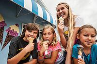 The Kelly children, from left, Nicholas , 4, Sage, 11, Adessa, 9, Athena, 12 and Kira, 6, enjoy ice cream at For Heaven Shakes in downtown Bonita Springs, Florida, USA. Photo by Debi PIttman Wilkey