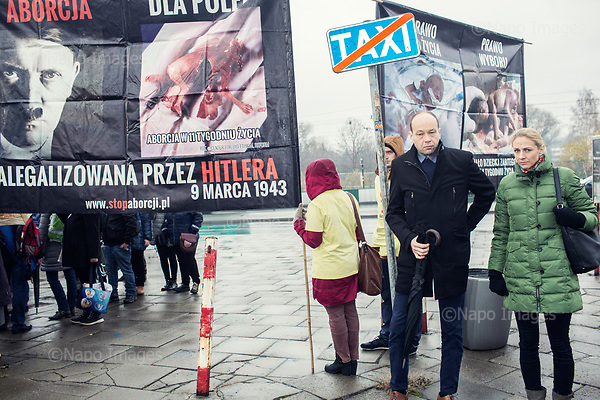 Krakow Lagiewniki 19.11.2016 Poland<br /> Members of the anti-abortion movement facing the entrance to the monastery with anti-abortion banners during ceremony where Polish Bishops and President Andrzej Duda declared Christ King of Poland.<br /> <br /> Photo: Adam Lach / Napo Images for GEO Magazine