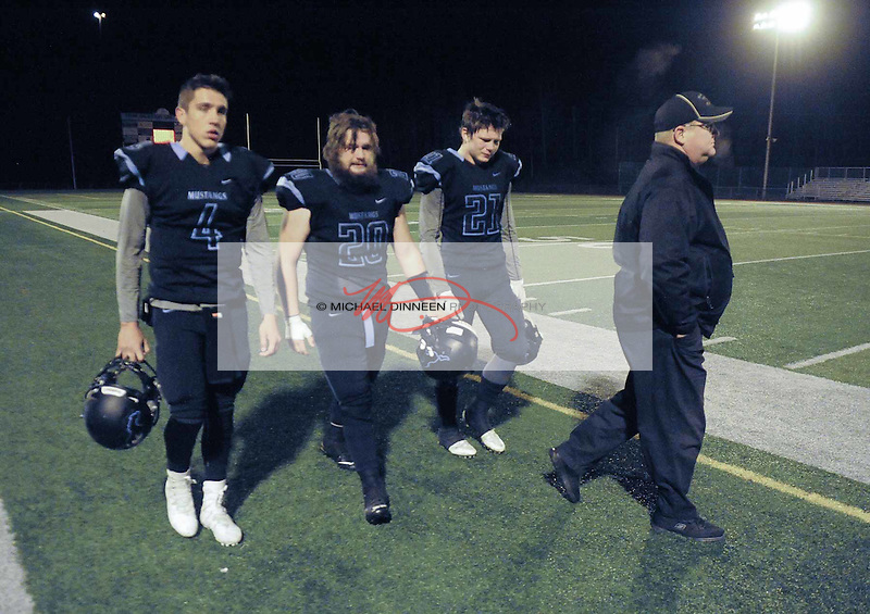 From left, Mustang team members  Hunter Harr, Merrick Johnson,   Derryk Snell and coach Roger Spackman leave the field at Chugiak Friday, October 7, 2016.   Photo for the Star by Michael Dinneen