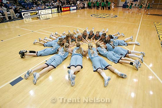 Sky View team huddle on the floor pre-game. Taylorsville - Provo vs. Sky View High School, 4A Girls State Basketball Championships at Salt Lake Community College.