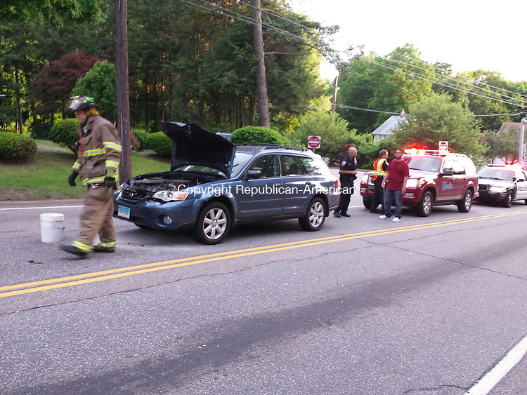 TORRINGTON, CT- 29 May 2014- 052914BJ01-- Firefighters and police were at the scene of two-vehicle crash on East Main Street Thursday evening. Bruno Matarazzo Jr. Republican-American