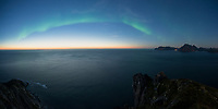 Early September northern lights with glow on horizon, Myrland, Flakstadøy, Lofoten Islands, Norway
