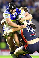 PICTURE BY ALEX WHITEHEAD/SWPIX.COM - Rugby League - Super League Play-Off - Warrington Wolves vs St Helens - The Halliwell Jones Stadium, Warrington, England - 15/09/12 - Warrington's Chris Hill is tackled by St Helens' James Roby and Anthony Laffranchi.