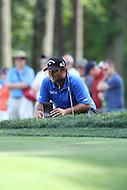 June 28, 2014 (Bethesda, Maryland).  Patrick Reed reading his putt attempt on hole 12  during Round 3 of the Quicken Loan National at the Congressional Country Club in Bethesda, MD. (Photo by Elliott Brown/Media Images International)