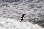 A Surfer seen from the Oceanside Pier, on visit to Oceanside, CA, on Wednesday, April 27, 2016. Photo by Jim Peppler. Copyright Jim Peppler  2016.
