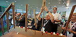 """Participants help construct a bridge during the """"Faith Building Bridges"""" conference in Amsterdam, Netherlands. The July 21-22 interfaith event, sponsored by the World Council of Churches-Ecumenical Advocacy Alliance, was held on the eve of the 2018 International AIDS Conference."""