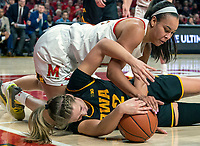 COLLEGE PARK, MD - FEBRUARY 13: Stephanie Jones #24 of Maryland battles for the ball with Kathleen Doyle #22 of Iowa during a game between Iowa and Maryland at Xfinity Center on February 13, 2020 in College Park, Maryland.