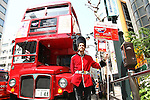 May 5, 2010 - Tokyo, Japan - A Japanese model dressed as a guardsman, stands next to a Routemaster bus in Tokyo, Japan on May 5, 2010. The double-decker legend is used during the public holidays called 'Golden Week' as free shuttle between Shibuya and Aoyama for the promotion of the British luxury brand group Vulcanize London.