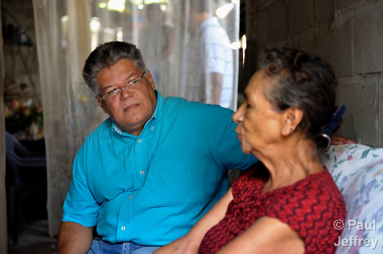 The Rev. JosŽ Roberto Pe–a-Nazario is a United Methodist missionary in Danli, Honduras. Here he visits with Olimpia Garcia, a member of his congregation.