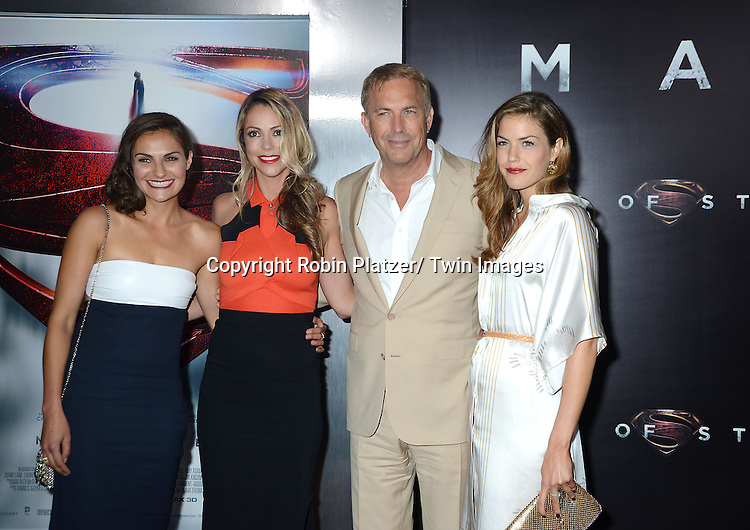 "Kevin Kostner and wife and daughters attend the World Premiere of ""Man of Steel"" on June 10, 2013 at Alice Tully Hall in New York"