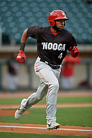 Chattanooga Lookouts Narciso Crook (4) runs to first base during a Southern League game against the Birmingham Barons on May 1, 2019 at Regions Field in Birmingham, Alabama.  Chattanooga defeated Birmingham 5-0.  (Mike Janes/Four Seam Images)